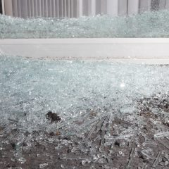 Sliding glass door that has been shattered by a home invader