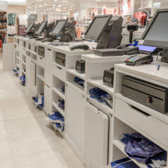 Electronic cash or modern cashier standing at the counter in a large empty store dressing room